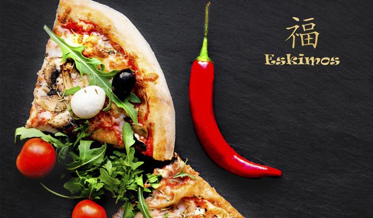Скидка 50% на горячие пироги и итальянскую пиццу от службы доставки Eskimos
